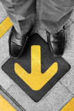 Man standing on road with direction arrow Royalty Free Stock Photo