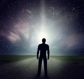 Man standing on the road looking at stars, sky, universe. Dream, adventure. Stock Photography