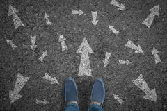 Man standing on road with many direction arrow choices or move Royalty Free Stock Photos