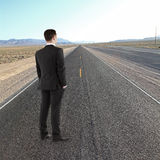 Man standing on road Royalty Free Stock Image