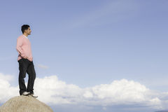 Man Standing on Rock Looking into Distance Royalty Free Stock Images