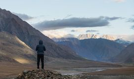 A man standing on the rock looking at mountains in the morning in India. A man standing on the rock looking at mountain in the morning in India stock photos
