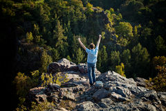 Man standing on a rock slope Stock Images