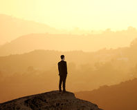 Man standing on rock Royalty Free Stock Image