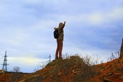 Man standing on rock. Tourist stand alone on a rock. stock photos