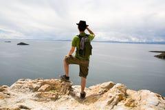 Man standing on rocks. Lake Titicaca, Bolivia Stock Photo