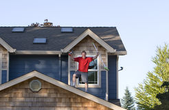 Man Standing On Roof Royalty Free Stock Images