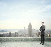 Man standing on roof Stock Images