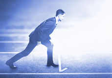 Man standing on running track royalty free stock images