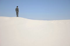 A man standing on a sand dune. In White Sands National Monument, New Mexico, USA Stock Images