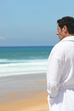 Man standing by the sea Royalty Free Stock Photos