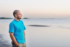 Man standing by the sea. Courageous bald man standing by the sea Stock Photos