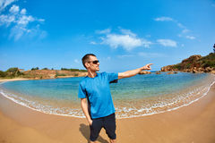 Man standing in the sea on the beach. Stock Photography
