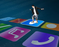 Man standing on shiny cloud icon with colorful app buttons Stock Photo