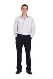 Man standing in shirt and pants isolated. More images of this models you can find in my portfolio Stock Images