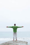 Man standing at the shoreline Royalty Free Stock Image