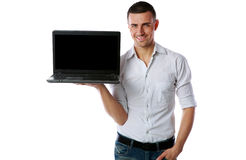 Man standing and showing laptop with blank screen Royalty Free Stock Image