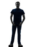 Man standing smiling with thumbs in pockets silhouette Royalty Free Stock Photography