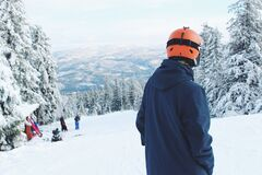 Man Standing on Snow Covered Mountain Stock Photos