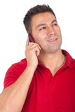Man standing and speaking at the phone Stock Image