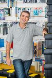 Man Standing By Stacked Toolboxes In Store Stock Photo