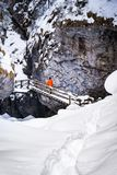 Man standing on stairs in frozen snow covered gorge Baerenschuetzklamm. In winter Royalty Free Stock Images