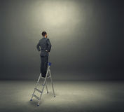Man standing on the stepladder Stock Photos