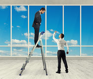 Man standing on stepladder and looking Royalty Free Stock Image