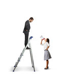 Man standing on the stepladder and looking Royalty Free Stock Photography