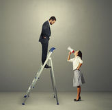 Man standing on stepladder and looking Stock Photos