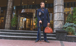 Man standing on street with luggage Royalty Free Stock Images