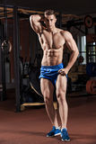 Man standing strong in the gym and flexing muscles Royalty Free Stock Photography