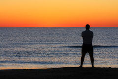 Man Standing Sunrise Sunset Beach Contemplation Stock Photography