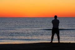 Man Standing Sunrise Sunset Beach Contemplation stock photography