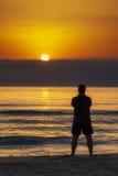Man Standing Sunrise Sunset Beach Contemplation Stock Photo