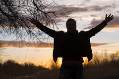 Man is standing in the sunset Stock Photo