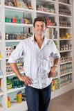 Man Standing In Supermarket Stock Photos