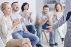 Man standing in support group royalty free stock photos