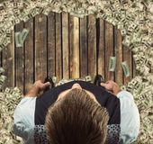 Man standing  surrounded with dollars Royalty Free Stock Images