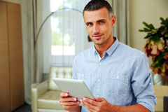 Man standing with tablet computer Stock Images
