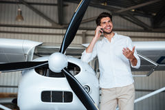 Man standing and talking on mobile phone near the plane Royalty Free Stock Photography