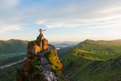 Man standing on top of cliff Stock Image