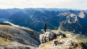 Man Standing on Top of the Mountain Royalty Free Stock Photography