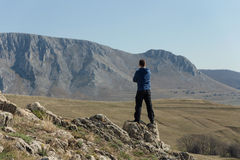 Man standing on top of mountain Royalty Free Stock Image