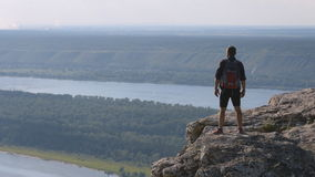 Man standing on top of a mountain with hands raised, Russia . The concept of freedom. stock footage