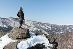 Man standing at top of the mountain, Mountain Round, Altai, Russia Royalty Free Stock Images