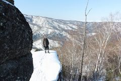 Man standing at top of the mountain, Mountain Round, Altai, Russia Royalty Free Stock Photos