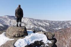 Man standing at top of the mountain, Mountain Round, Altai, Russia Royalty Free Stock Photo