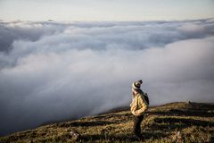 Man Standing on Top of Moutain Stock Images