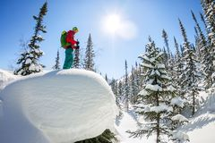 Man standing at top of ridge. Ski touring in mountains. Adventure winter freeride extreme sport.  Stock Photos